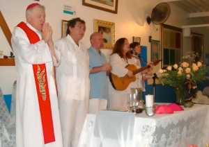 Rev. Nettie plays music for Padre Ron Roth & John of God in Brazil in 2004