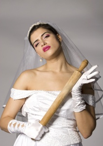 Killer bride photo series. Bridezilla with wooden rolling pin. Studio shot